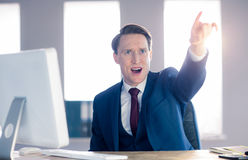 Angry businessman pointing and shouting Royalty Free Stock Images