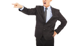 Angry businessman pointing with yelling. Angry businessman pointing to something with yelling over white stock photos