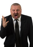 An angry businessman points at the camera Stock Image
