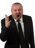 An angry businessman points at the camera Stock Photo