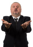 An angry businessman points at the camera Stock Photography