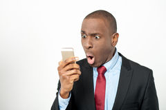 Angry businessman reading text messages Royalty Free Stock Images