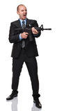 Angry businessman with rifle Stock Image
