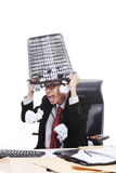 Angry businessman with rubbish bin on his head Royalty Free Stock Photography