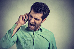 Angry businessman screaming on mobile phone Royalty Free Stock Photo