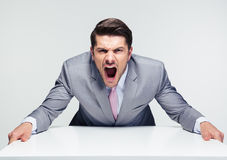 Angry businessman screaming Stock Images