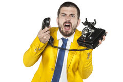 Angry businessman screaming to the phone, funny facial expressio. Angry business man screaming to the phone, funny facial expressions Royalty Free Stock Image