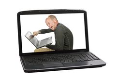 Angry businessman in screen from a laptop. Angry businessman is destroying his laptop in screen from a laptop Stock Image