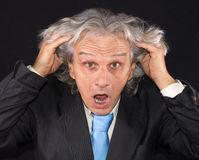 Angry businessman. Angry senior businessman on black background Royalty Free Stock Image