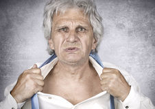 Angry businessman. Angry senior businessman on silver background Royalty Free Stock Images
