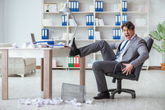 The angry businessman shocked working in the office fired sacked Stock Image