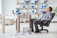 The angry businessman shocked working in the office fired sacked Stock Photo