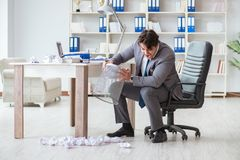 The angry businessman shocked working in the office fired sacked. Angry businessman shocked working in the office fired sacked Royalty Free Stock Photo