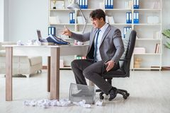 The angry businessman shocked working in the office fired sacked. Angry businessman shocked working in the office fired sacked Stock Image