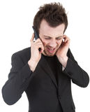 Angry businessman shouting on his mobile Royalty Free Stock Image