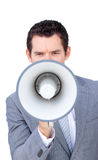 Angry businessman shouting through a megaphone Royalty Free Stock Photo
