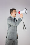 Angry businessman shouting through megaphone Royalty Free Stock Photo