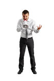 Angry businessman shouting in megaphone Royalty Free Stock Image