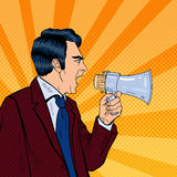 Angry Businessman Shouting in Megaphone. Pop Art. Vector illustration Stock Images
