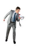 Angry businessman shouting through megaphone Royalty Free Stock Image
