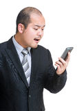 Angry businessman shouting on mobile Stock Images