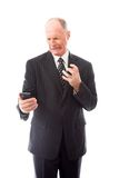 Angry businessman shouting on a mobile phone Stock Images