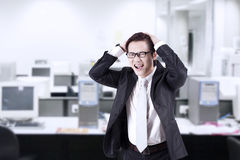 Angry businessman shouting at office Stock Images