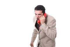 Angry businessman shouting on the phone. Isolated on white Royalty Free Stock Photography
