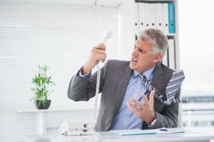 Angry businessman shouting on the phone Stock Photography