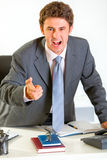 Angry businessman shouting and pointing on you Royalty Free Stock Images