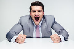 Angry businessman shouting Royalty Free Stock Image