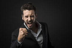 Angry businessman showing fists Royalty Free Stock Photos