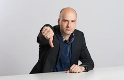 Angry businessman shows his thumb down Royalty Free Stock Images