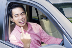 Angry businessman shows middle finger Stock Images