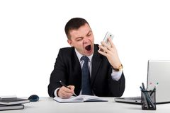 Angry businessman with smartphone shouting isolated on white background. Office, finances, internet, business, success and stress concept-Angry businessman with Royalty Free Stock Images