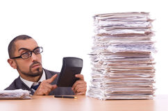 Angry businessman with stack Stock Image