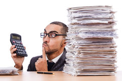 Angry businessman with stack Royalty Free Stock Photo