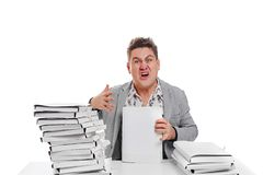 Angry businessman with stack of papers.  on white backgr. Ound Royalty Free Stock Photo