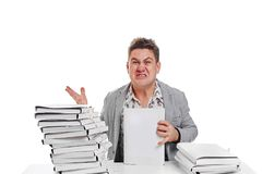 Angry businessman with stack of papers.  on white backgr. Ound Stock Images