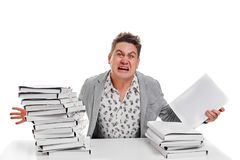 Angry businessman with stack of papers.  on white backgr. Ound Royalty Free Stock Image