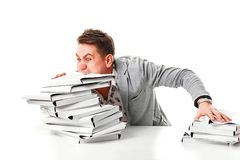 Angry businessman with stack of papers.  on white backgr. Ound Royalty Free Stock Images