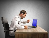 Angry businessman. Stressed and angry businessman work at laptop Royalty Free Stock Photos