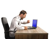 Angry businessman. Stressed and angry businessman work at laptop Stock Image