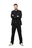 Angry businessman in suit and sneakers with crossed arms Royalty Free Stock Photos