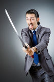 Angry businessman with sword Royalty Free Stock Images