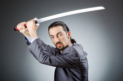 Angry businessman with sword Royalty Free Stock Photo