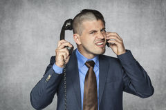 Angry businessman talking on the phone Royalty Free Stock Image