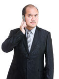 Angry businessman talking on phone Royalty Free Stock Photos