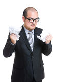 Angry businessman tear off paper. Isolated on white Stock Images