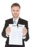 Angry businessman tearing contract paper Royalty Free Stock Photography